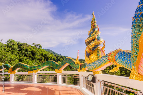 Foto op Aluminium Bedehuis A very beautiful Naga (a very great serpent) statue surrounding the pagoda at Doi Thepnimit temple on Patong hilltop,Phuket, Thailand.