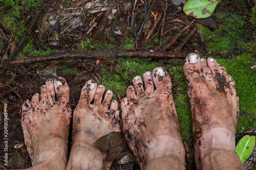 Dirty feet on moss in jungle Canvas Print