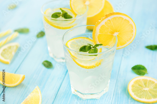 Sweet and sour lemonade juice with ice cubes in the glasses