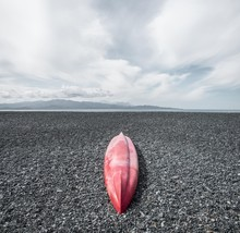 View Of Red Canoe On The Black Stone Beach Of Albo