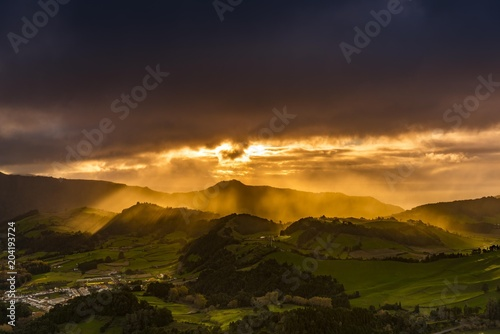 Hilly landscape and dramatic atmospheric lighting, dark clouds, Furnas, Sao Miguel, Azores, Portugal, Europe