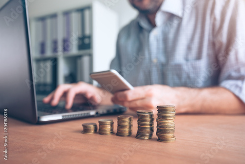 Obraz na plátne  Coin stacker, businessman with stacked money