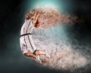 Basketball player with ball in action outdoors