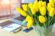 Leinwanddruck Bild - Large beautiful bouquet of yellow tulips on a desk in the office. Congratulations on the holiday or birthday. Flowers as a gift.