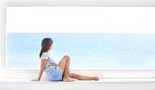 Young Girl On Window Look On Sea