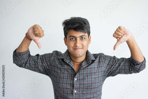 Confident Indian guy proud of success Wallpaper Mural