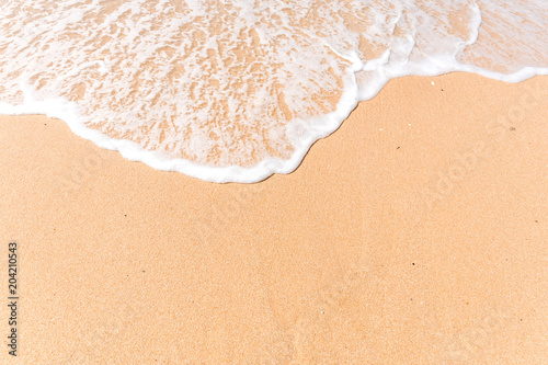 Foto auf Leinwand Wasser Tropical beach background with soft wave and white sand