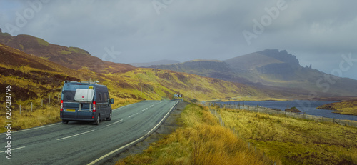 Photo  Campervan Driving on Countryside Road