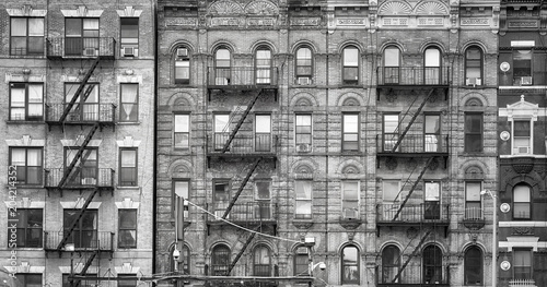 Tuinposter New York City Black and white picture of old buildings with fire escapes, one of the New York City symbols, USA.
