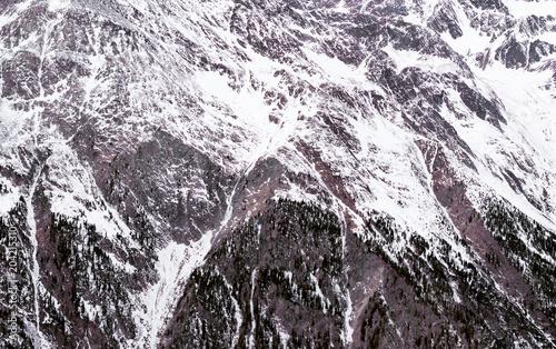 Foto auf Gartenposter Gebirge Winter Alpine background. The mountainous terrain in the snow