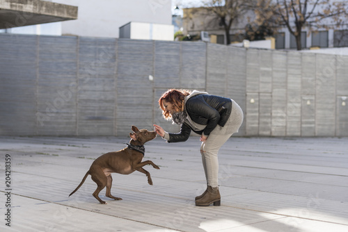 Woman playing with her dog in Jaen, Spain.