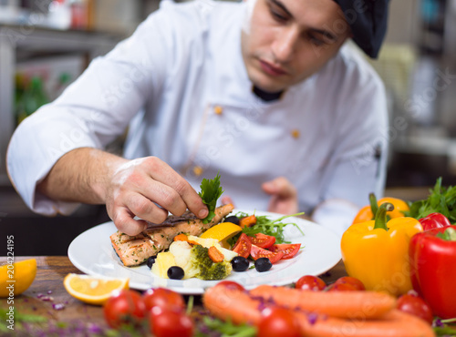 Fototapeta cook chef decorating garnishing prepared meal obraz
