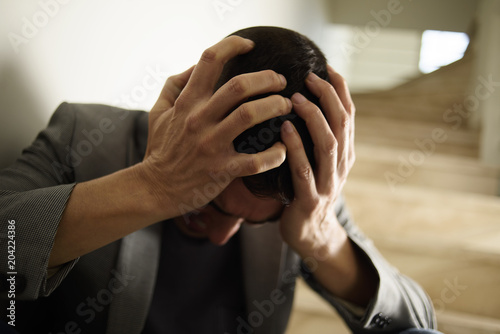 desperate man with his hands in his head Wallpaper Mural