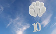 canvas print picture Number 10 party celebration. Number attached to a bunch of white balloons against blue sky