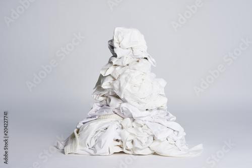 Fotografie, Obraz  Laundry heap on the grey background