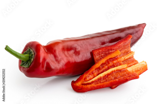 Fototapeta Ramiro sweet pointed pepper isolated on white and two cut pieces without seeds