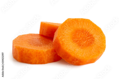 Three round slices of peeled carrot isolated on white.