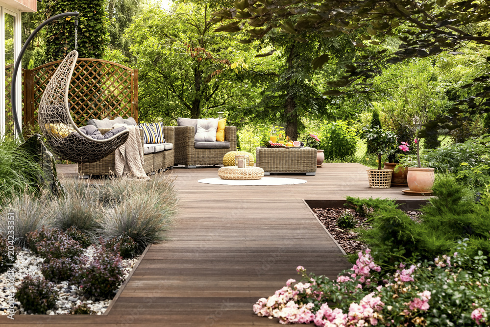 Fototapety, obrazy: Wooden terrace surrounded by greenery
