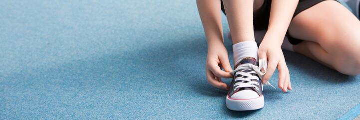 Panorama of child binding shoe