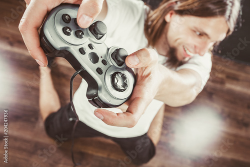 Photo  Happy man playing games