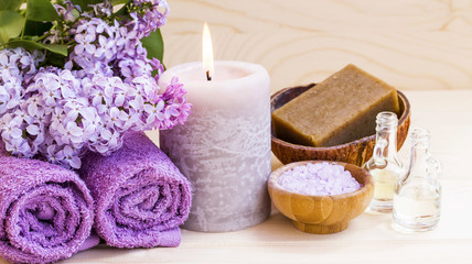 Spa setting with lilac, towels and candle, still life of wellness spa