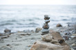 Image of Pebble tower on the beach. Stone wishing Pyramid on the shore of the sea