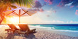 canvas print picture - Two Deckchairs Under Parasol In Tropical Beach At Sunset