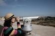 girl looks at panorama with binoculars