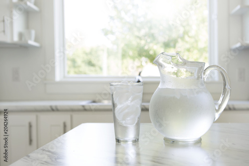 Fototapeta A pitcher and glass of ice water obraz