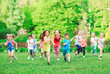 Leinwanddruck Bild - Many different kids, boys and girls running in the park on sunny summer day in casual clothes