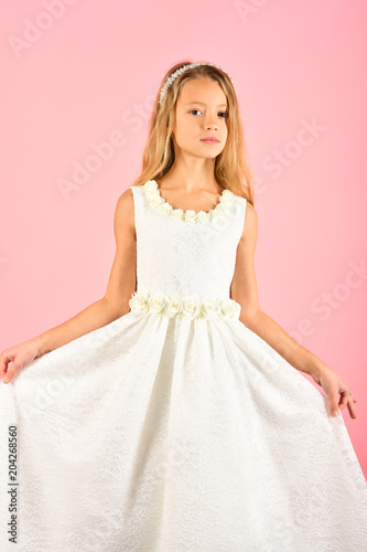58841b00e10f Child girl in stylish glamour dress, elegance. Look, hairdresser, makeup.  Fashion and beauty, little princess. Little girl in fashionable dress, .