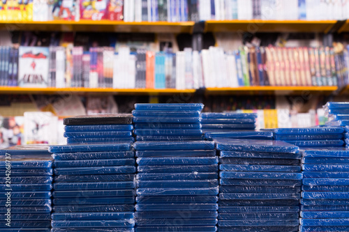 Photo Stands Music store Stacks of new DVDs in store