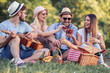 canvas print picture Happy young people enjoying picnic party