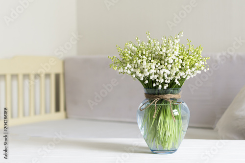 Foto op Aluminium Lelietje van dalen Living room interior design with still life, blossom lily of the valley in vase