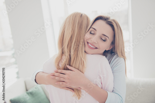 Portrait of cute charming lovely beloved sweet girl enjoying warm hugs with her Tableau sur Toile