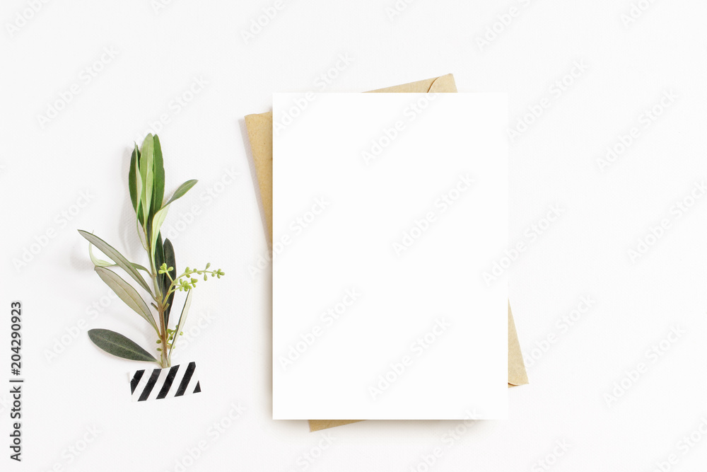 Fototapety, obrazy: Feminine stationery, desktop mock-up scene. Blank greeting card, craft envelope, washi tape and with olive branch.White table background. Flat lay, top view.