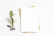 canvas print picture - Feminine stationery, desktop mock-up scene. Blank greeting card, craft envelope, washi tape and with olive branch.White table background. Flat lay, top view.
