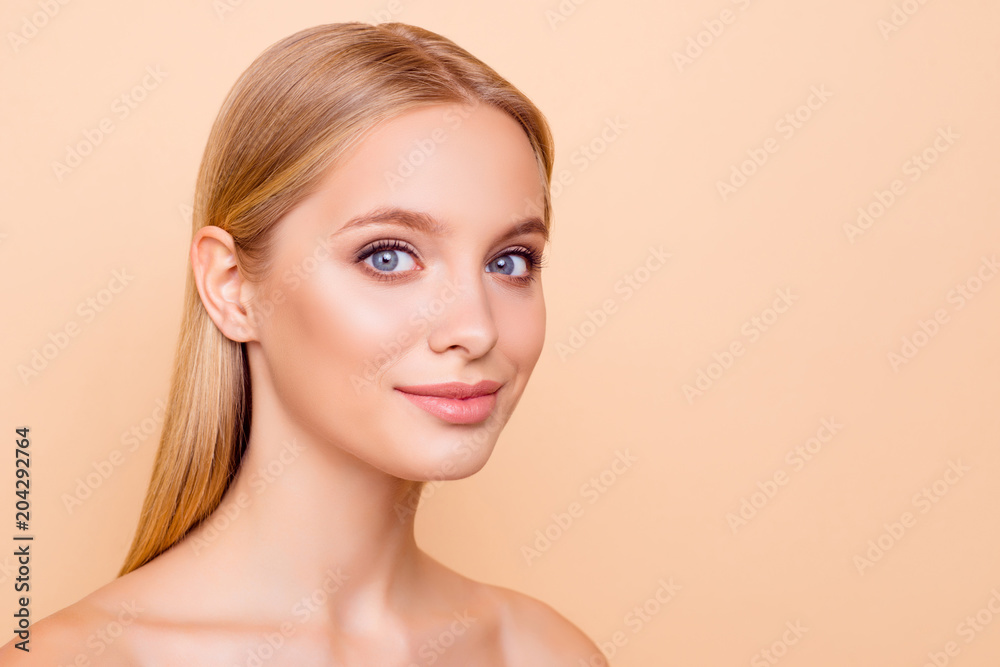 Fototapety, obrazy: Portrait with copy space empty place of pretty charming cute, natural, half turned girl with plump lips looking at camera having perfect skin isolated on beige background, advertisement concept