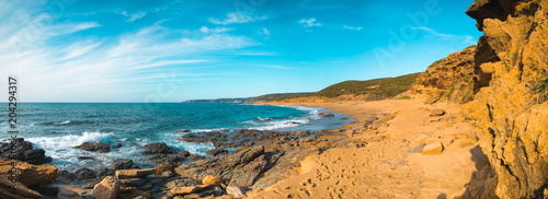 Landscape on the beach of Gutturu and Flumini with rocks and waves Canvas Print