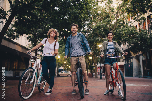 Young people touring the city on bicycles Canvas
