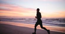 Healthy Man Jogging Along The ...