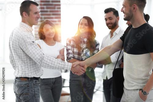 Staande foto Hoogte schaal handshake business partners in the creative office.