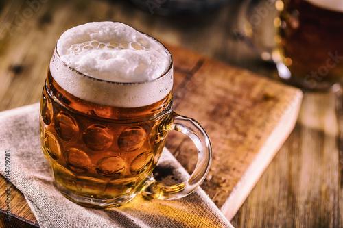 Fotobehang Bier / Cider Close-up cold draft beer on wooden board