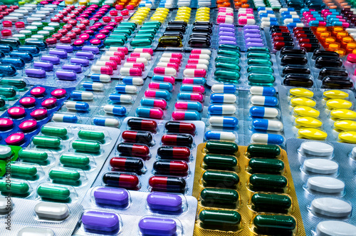 Valokuva  Colorful of tablets and capsules pill in blister packaging arranged with beautiful pattern