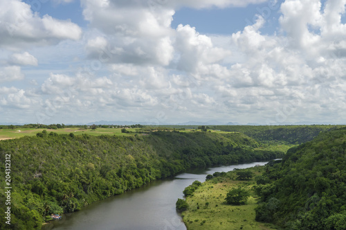 Foto op Aluminium Bleke violet Chavon River, riverbed, tropical vegetation, the sky is covered with clouds in the background, the province of La Romana, the Dominican Republic