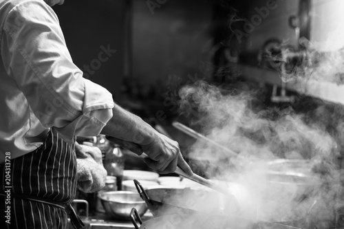 Fotografía  Chef is stirring