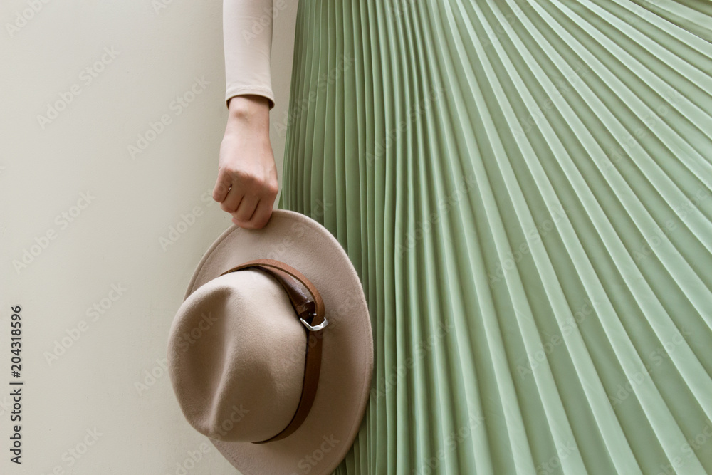 Fototapety, obrazy: Hat, beige blouse and turqoise pleats skirt on light street backgraund.  Fashion and stylish concept.