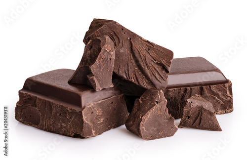 Fototapeta Pieces of dark chocolate isolated on white background.