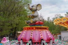 Bright Carousel With An Elephant In The Park