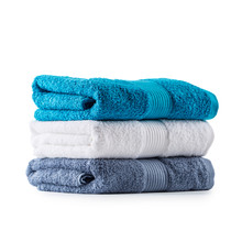 Stacked Blue White And Gray Towels Isolated On White